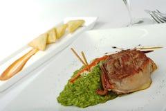 Piatto principale: Carne con il riso degli spinaci fotografia stock libera da diritti