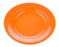 Piatto vuoto arancio su fondo bianco Fotografia Stock Libera da Diritti