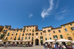 Piazza Anfiteatro - Lucca Tuscany Italy. LUCCA, ITALY - APRIL 16, 2017: Tourists and locals visit the ancient Town square Piazza dell`Anfiteatro - Amphitheater Royalty Free Stock Image