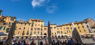 Piazza Anfiteatro - Lucca Tuscany Italy. LUCCA, ITALY - APRIL 16, 2017: Tourists and locals visit the ancient Town square Piazza dell`Anfiteatro - Amphitheater Royalty Free Stock Photo