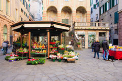 Piazza Banchi, Genoa. GENOA, ITALY - JAN 24, 2015: Scene of Piazza Banchi and San Pietro church, with shops, local and tourists, in Genoa, Liguria, Italy Royalty Free Stock Photo