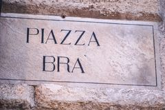 Piazza Bra street name sign, Verona, Italy. Piazza Bra street name sign, the largest piazza in Verona, Italy. The Verona Arena and Verona`s town hall The Gran stock image