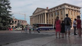 Piazza bra a verona, video with passers-by at the arena of Verona, point of reference for operas and shows visited every day by th