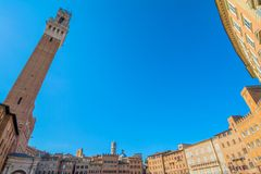 Piazza Campo square and Mangia Tower, Siena, Italy Royalty Free Stock Image