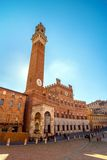 Piazza Campo square and Mangia Tower, Siena, Italy Royalty Free Stock Images