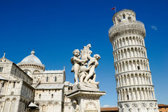 Piazza dei Miracoli. The Pisa Cathedral, The Fountain with Angels, and the Leaning Tower of Pisa in Piazza dei Miracoli in Pisa, Italy Royalty Free Stock Photography