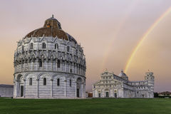 Piazza dei Miracoli in Pisa. Piazza dei Miracoli with a rainbow over the leaning tower o Pisa Stock Photos