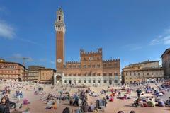 Piazza del Campo en Palazzo Publico, Siena, Italië Stock Fotografie