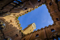Piazza del Campo is the main square of Siena with view on Palazzo Pubblico Stock Photography