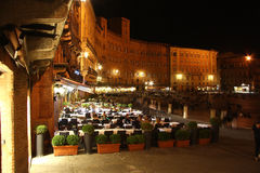 Piazza del Campo in Siena (Italy) at night. Famous Piazza del Campo in the historic center of Siena, Tuscany, Italy at night. One of Europes greatest medieval Royalty Free Stock Photos