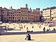 Piazza del campo in siena, italy. People resting on piazza del campo in siena, italy Royalty Free Stock Photography
