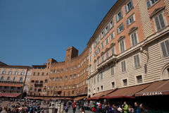 Piazza del Campo Siena, with throngs of people. Royalty Free Stock Images