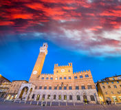 Piazza del Campo at sunset with Palazzo Pubblico, Siena, Italy Stock Photo