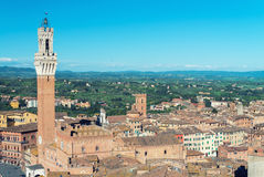 Piazza del Campo at sunset with Palazzo Pubblico, Siena, Italy Royalty Free Stock Images