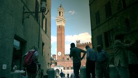 Piazza del Campo and Town Hall,Siena,ULTRA HD 4K, real time. People walking in Piazza del Campo and Town Hall,Siena,ULTRA HD 4K, real time stock video footage