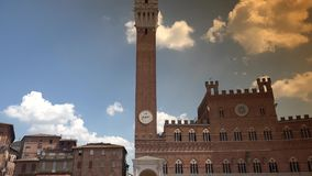 Piazza del Campo and Town Hall,Siena,ULTRA HD 4K, real time. People walking in Piazza del Campo and Town Hall,Siena,ULTRA HD 4K, real time stock video
