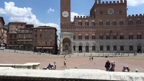 Piazza del Campo and Town Hall,Siena,ULTRA HD 4K, real time. People walking in Piazza del Campo and Town Hall,Siena,ULTRA HD 4K, real time stock footage