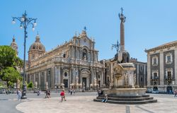 Piazza del Duomo in Catania on a summer morning, with Duomo of Saint Agatha and the Elephant Fountain. Sicily, southern Italy. royalty free stock image