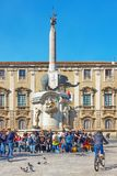 Piazza del Duomo and Fontana dell Elefante. Catania, Italy - March 15, 2019: People in Piazza del Duomo near Fontana dell Elefante - symbol of the city of royalty free stock photo