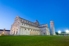 Piazza del Duomo with Pisa tower and the Cathedral illuminated a Royalty Free Stock Image