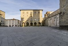The Piazza del Duomo in Pistoia and the Palazzo del Comune without people, Tuscany, Italy stock photo