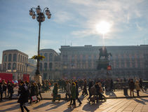 Piazza del Duomo on a sunny day with a lot of people walking. MILAN, ITALY - DECEMBER 09, 2016: Duomo di Milano on a sunny day full of people walking. Metro Royalty Free Stock Photos
