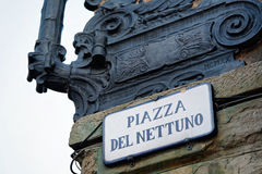 Piazza del Nettuno Street sign on wall in Bologna. Piazza del Nettuno Street sign on the wall in Bologna, Italy royalty free stock image