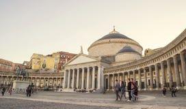Piazza del Plebiscito with tourists visiting famous monument San Francesco di Paola Naples, Stock Image