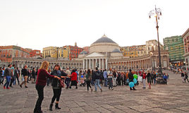 Piazza del Plebiscito with tourists visiting famous monument San Francesco di Paola Naples, Stock Photography