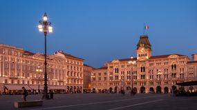 Piazza dell`Unita in Trieste with Palazzo del Municipio shot at sunset in soft pink light royalty free stock photo
