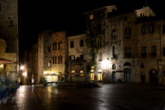 Piazza della Cisterna at night in San Gimignano city in Italy Royalty Free Stock Image
