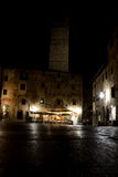 Piazza della Cisterna at night in San Gimignano city in Italy Royalty Free Stock Images