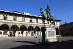 Piazza della Santissima Annunziata in Florence, Italy. The Piazza della Santissima Annunziata with the historical equestrian statue of  Ferdinand I of Tuscany Royalty Free Stock Photos