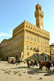 Piazza della Signoria in Florence, Italy. The Palazzo Vecchio is the town hall of Florence, Italy. This massive, Romanesque, crenellated fortress-palace is among stock photo