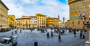 Piazza della Signoria in Florence, Italy. Panorama of piazza della Signoria, is an L-shaped square in front of Palazzo Vecchio in Florence, Italy. It was named royalty free stock photography
