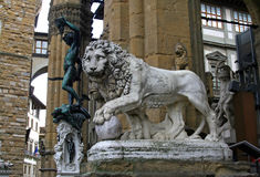 Piazza della Signoria lion. Bronze sculpture of a warrior Perseus with the Gorgon`s head lion marble Royalty Free Stock Images