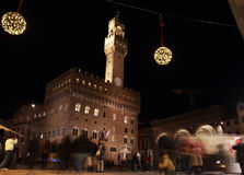 Piazza della Signoria by Night, Florence. FLORENCE, ITALY - DECEMBER 7, 2014: People in Piazza della Signoria at night under Christmas lights Stock Image