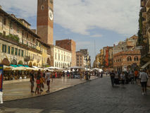 Piazza delle Erbe in Verona. VERONA, ITALY - CIRCA JULY 2016: Tourists in Piazza delle Erbe (meaning Market Square Royalty Free Stock Photography