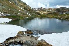 Lago della montagna delle alpi Immagine Stock