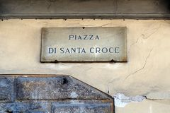 Piazza Di Santa Croce, Florence, Italy. A marble street sign mounted high on a stucco wall  identifying the Piazza di Santa Croce, a central plaza or square in Stock Photos
