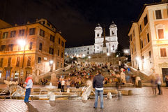 Piazza di Spagna night peoples life and Trinita dei Monti Stock Photos