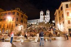 Piazza di Spagna night peoples life and Trinita dei Monti Stock Photos