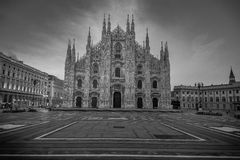 Monochrome of the Milan Cathedral Duomo. A black and white of the Cathedral Duomo square Milan, Italy with sunlight behind the church royalty free stock image
