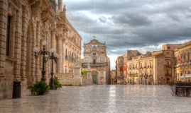 Piazza Duomo, Syracuse, Sicily, Italy. The old market and duomo square in Orgtigia with the Santa Lucia alla Badia , Syracuse, Siracusa, Sicily, Italy