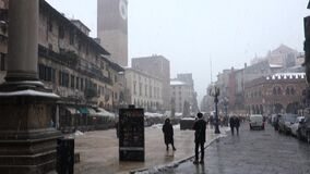 Piazza Erbe, Verona city in Italy. Classic image of snowing day stock video