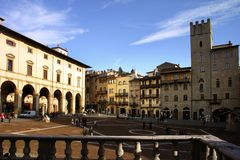 Piazza Grande, Arezzo - Italy. A view of the medieval central Piazza Grande of Arezzo, Tuscany, Italy, taken from the famous architect Vasari's balconade