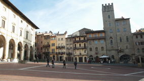 Piazza Grande in Arezzo, Tuscany, Italy. AREZZO, ITALY - JANUARY  12, 2014: people in the Piazza Grande square, this is the most noteworthy medieval square in stock video