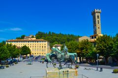 Piazza Mino Mino square with Cattedrale di San Romolo Duomo d. I Fiesole, Fiesole Cathedral at background in Fiesole, Italy royalty free stock photo