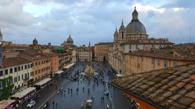 Piazza Navona aerial view, Rome, Italy. Aerial view of people gathered in Piazza Navona in Rome, Italy with cloudy skies in daytime royalty free stock photos