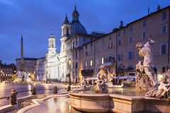 Piazza Navona at dusk, Rome. Piazza Navona fountains and statue, Rome, Italy royalty free stock image